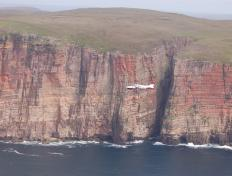 The OY-PHK along the cliffs of Hoy Island