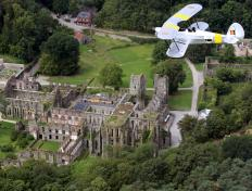Our Stampe SV4-B OO-GWB, overflying the ruins of the Abbey of Villers-la-Ville